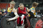 Canada plays Sweden in the London International Invitational Wheelchair Rugby Tournament in the Basketball Arena of the Olympic Park, London. - Philip Wolmuth - 2010s,2012,basketball,bound,Canada,disabilities,disability,disable,disabled,disablement,game,games,incapacity,London,minorities,mobility,needs,Olympic,Olympics,paralympians,Paralympic,paralympics,Para