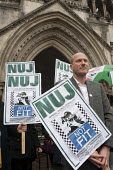 Videographer Jason N Parkinson joins a protest outside the Royal Courts of Justice, called by the NUJ London Photographers Branch on the day of a judicial review of a decision to grant a Production Or... - Philip Wolmuth - 2010s,2012,activist,activists,adult,adults,CAMPAIGN,campaigner,campaigners,CAMPAIGNING,CAMPAIGNS,Court,courts,DEMONSTRATING,demonstration,DEMONSTRATIONS,Essex,eviction,Farm,FIT,journalism,journalist,j