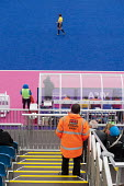 A security guard employed by private contractor Securitas on duty during an international womens hockey event at the Riverbank Arena in the Olympic Park, Stratford. - Philip Wolmuth - 05-05-2012