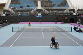Serving. Wheelchair Tennis International competitiion at the Eton Manor arena in the London 2102 Olympic Park. - Philip Wolmuth - 2010s,2012,bound,court,disabilities,disability,disable,disabled,disablement,game,games,incapacity,London,London 2012,minorities,mobility,needs,Olympic,Olympics,paralympians,Paralympic,paralympics,Park