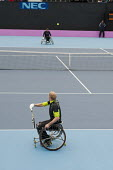 Volly. Wheelchair Tennis International competitiion at the Eton Manor arena in the London 2102 Olympic Park. - Philip Wolmuth - 2010s,2012,bound,court,disabilities,disability,disable,disabled,disablement,game,games,incapacity,London,London 2012,minorities,mobility,needs,Olympic,Olympics,paralympians,Paralympic,paralympics,Park