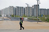 A security guard on patrol. London 2012 Olympic Park and Athletes Village, Stratford. - Philip Wolmuth - 05-05-2012