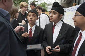 Students from Featherstone High School, in Ealing, London, promote their Oyster on the Go smartphone app at the Apps for Good Awards 2012, the Barbican, London. - Philip Wolmuth - 2010s,2012,apps,ASIAN,ASIANS,BAME,BAMEs,black,BME,bmes,child,CHILDHOOD,children,cities,City,COMPUTE,COMPUTER,COMPUTERS,computing,digital,diversity,economic,economy,EDU,educate,educating,Education,educ