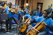Schoolchildren from the Lambeth In Harmony project, which is based on the Venezuelan El Sistema music education programme devised by composer and social visionary Jos - Philip Wolmuth - ,2010s,2012,BAME,BAMEs,black,BME,bmes,boy,boys,child,CHILDHOOD,children,cities,city,diversity,EDU,educate,educating,Education,educational,ethnic,ethnicity,female,females,girl,girls,instruments,juvenil