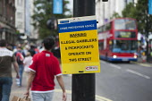 A police crime prevention notice in Oxford Street, London, during the 2012 Olympic Games. Warning that illegal gamblers and pickpockets operate on this street. - Philip Wolmuth - 08-08-2012