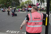 A London 2012 Olympic Games steward on duty at a road crossing at Marble Arch. - Philip Wolmuth - 08-08-2012
