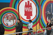 Pedestrians walking past a Coca-Cola advertisement on route to the London 2102 Olympic Park in Stratford. - Philip Wolmuth - 08-08-2012