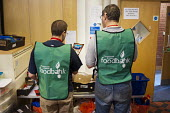 Volunteers preparing an order in the storeroom of Hammersmith & Fulham foodbank. The Trussell Trust, a Christian charity, London - Philip Wolmuth - &,2010s,2012,bag,bags,belief,charitable,charity,christian,christianity,christians,church,churches,cities,city,conviction,distributing,distribution,EQUALITY,excluded,exclusion,faith,food,Food Aid,food