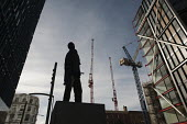 The Monument to an Unknown Artist, an animatronic sculpture by the public art collective Greyworld, looks over a new development in Southwark, London. Sale prices for flats in Neo Bankside range from... - Philip Wolmuth - 123,2010s,2012,ACE,apartments,art,Artist,ARTISTS,Arts,artwork,artworks,Bankside,blocks,Brownfield Site,building,building site,buildings,cities,city,City centre,cityscape,cityscapes,construction,Constr
