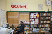 A volunteer librarian at Friern Barnet library, which has been restocked and reopened as The People's Library and community hub by activists and local residents. - Philip Wolmuth - 2010s,2012,activist,activists,Austerity Cuts,Barnet,book,books,CAMPAIGN,campaigner,campaigners,CAMPAIGNING,CAMPAIGNS,communities,community,Council,Council Services,Council Services,cuts,DEMONSTRATING,