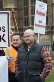 Bob Crow, RMT Gen Sec. RMT and CWU members demonstrate outside parliament in protest at government plans to cut payments to the victims of violent crime through the Criminal Injuries Compensation Sche... - Philip Wolmuth - 12-11-2012