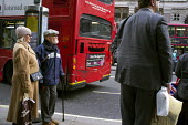 Elderly passengers waiting at a bus stop, The Strand, London - Philip Wolmuth - 22-11-2012