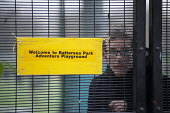An Occupy London activist inside the now locked Battersea Park adventure playground. Activists and local residents oppose Wandsworth Council plans to demolish the playground, and replace it with conve... - Philip Wolmuth - 08-01-2013