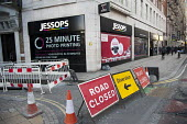 Closed down Jessops photographic equipment store in New Oxford Street, central London, asthe company went into administration. Road closed and diversion signs. - Philip Wolmuth - 2010s,2013,bankrupt,bankruptcy,business,cities,city,closed,closing,closure,closures,communicating,communication,company,DOWNTURN,EBF,Economic,Economic Crisis,Economy,equipment,High St,High Street,high