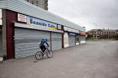 Empty shops in Margate, Kent. - Philip Wolmuth - 2010s,2013,adolescence,adolescent,adolescents,bicycle,bicycles,BICYCLING,Bicyclist,Bicyclists,bike,bikes,boarded up,boy boys,business,child children,closed,closed closure,closed down,closing,closure,c
