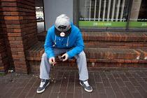 Unemployed young men outside Margate JobCentre. - Philip Wolmuth - 2010s,2013,agency,business,call,calls,CELLULAR,cigarette,CIGARETTES,communicating,communication,DOWNTURN,economic,Economic Crisis,economy,employee,employees,employment,job,Job centre,Jobcentre Plus,jo
