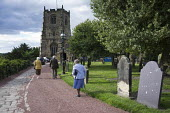 Elderly worshippers arrive for a Sunday evening service at St. Michael's Church in Alnwick, Northumberland. - Philip Wolmuth - &,2010s,2013,adult,adults,age,ageing population,ARRIVAL,arrivals,arrive,arriving,belief,cemeteries,CEMETERY,Christian,christianity,christians,church,Church of England,churches,churchyard,churchyards,c