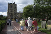 Elderly worshippers arrive for a Sunday evening service at St. Michael's Church in Alnwick, Northumberland. - Philip Wolmuth - ,&,2010s,2013,adult,adults,age,ageing population,ARRIVAL,arrivals,arrive,arriving,belief,cemeteries,CEMETERY,Christian,christianity,christians,church,Church of England,churches,churchyard,churchyards,