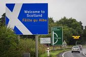 Welcome to Scotland road sign, Dumfries and Galloway. - Philip Wolmuth - 2010s,2013,border,communicating,communication,direction,directions,Flag,flags,highway,independence,pol,political,POLITICIAN,POLITICIANS,politics,referendum,road,ROADS,Saltire,Scotland,Scottish,Scottis