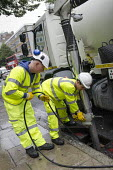 A London Highways Alliance gully cleaning crew at work on a Clean Up Day organised by Edgware Road Partnership. - Philip Wolmuth - 19-09-2013