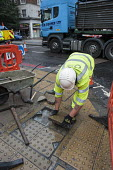 A London Highways Alliance pavement repair team at work on a Clean Up Day organised by Edgware Road Partnership. - Philip Wolmuth - 19-09-2013