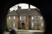 View through locked gates of Oak Lodge, one of a large number of empty mansions in The Bishops Avenue in north London, also known as Billionaire's Row. The house is owned by a Bahamas-registered compa... - Philip Wolmuth - 03-02-2014
