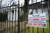 The Georgians, one of 10 empty and semi-derelict mansions in The Bishops Avenue in north London, sold by the Saudi royal family to the LJ Capital investment fund in 2013 for �73 million. Many other ma... - Philip Wolmuth - 2010s,2014,AFFLUENCE,AFFLUENT,bankrupt,bankruptcy,billionaire,billionaires,Boarded Up,Bourgeoisie,Capital,CCTV,cities,city,communicating,communication,crime prevention,derelict,DERELICTION,disused,EBF