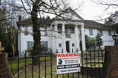 The Georgians, one of 10 empty and semi-derelict mansions in The Bishops Avenue in north London, sold by the Saudi royal family to the LJ Capital investment fund in 2013 for �73 million. Many other ma... - Philip Wolmuth - ,2010s,2014,AFFLUENCE,AFFLUENT,bankrupt,bankruptcy,billionaire,billionaires,Boarded Up,Bourgeoisie,Capital,cities,city,communicating,communication,derelict,DERELICTION,disused,EBF,Economic,Economy,eli