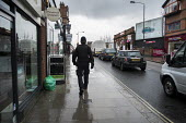 Police constable on the beat in West Hampstead, London. - Philip Wolmuth - 30-01-2014