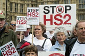 Stop HS2 demonstration outside Parliament on the day of the second reading of the HS2 Hybrid Bill. - Philip Wolmuth - 2010s,2014,activist,activists,against,anti,campaign,campaigner,campaigners,campaigning,CAMPAIGNS,DEMONSTRATING,demonstration,DEMONSTRATIONS,development,FEMALE,high,HS2,London,outside,Parliament,people