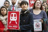 Stop HS2 demonstration outside Parliament on the day of the second reading of the HS2 Hybrid Bill. - Philip Wolmuth - 2010s,2014,activist,activists,against,anti,Borough,Camden,campaign,campaigner,campaigners,campaigning,CAMPAIGNS,DEMONSTRATING,demonstration,DEMONSTRATIONS,development,FEMALE,high,HS2,London,of,outside
