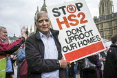 Stop HS2 demonstration outside Parliament on the day of the second reading of the HS2 Hybrid Bill. - Philip Wolmuth - 2010s,2014,activist,activists,against,anti,campaign,campaigner,campaigners,campaigning,CAMPAIGNS,DEMONSTRATING,demonstration,DEMONSTRATIONS,development,high,HS2,London,outside,Parliament,protest,PROTE
