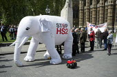 White elephant. Stop HS2 demonstration outside Parliament on the day of the second reading of the HS2 Hybrid Bill. - Philip Wolmuth - 2010s,2014,activist,activists,against,anti,campaign,campaigner,campaigners,campaigning,CAMPAIGNS,DEMONSTRATING,demonstration,DEMONSTRATIONS,development,high,HS2,London,outside,Parliament,protest,PROTE