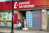 Shoppers outside Poundstretcher, Kentish Town Road, Camden, London. - Philip Wolmuth - 14-05-2014