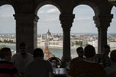 The Hungarian Parliament building in Pest, seen from a bar on the Buda side of the Danube, Budapest. - Philip Wolmuth - &,2010s,2014,bar,bars,building,BUILDINGS,catering,cities,city,City centre,cityscape,cityscapes,holiday,holiday maker,holiday makers,holidaymaker,holidaymakers,holidays,Hungarian,Hungary,leisure,lfL,LI