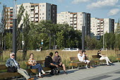 A park in front of residential housing blocks on the outskirts of Budapest. - Philip Wolmuth - &,2010s,2014,cities,city,estate,estates,High Rise,high-rise,housing,Hungarian,Hungarians,Hungary,leisure,LFL,LIFE,lifestyle,open,outdoors,park,parks,PEOPLE,public,RECREATION,RECREATIONAL,RESIDENT,resi