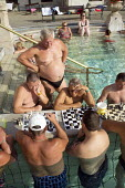 Men playing chess in the water at Szechenyi thermal baths, Budapest. - Philip Wolmuth - &,2010s,2014,activities,age,ageing population,bather,bathers,bathing,baths,board,cities,city,elderly,EXERCISE,exercises,game,games,hobbies,hobby,hobbyist,Hungarian,Hungarians,Hungary,leisure,LFL,LIFE,