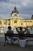 Two friends, Szechenyi thermal baths, Budapest. - Philip Wolmuth - &,2010s,2014,activities,bather,bathers,bathing,baths,cities,city,EXERCISE,exercises,friends,Hungarian,Hungarians,Hungary,leisure,LFL,LIFE,lifestyle,outdoor,Outdoor Activity,PEOPLE,pool,RECREATION,RECR