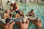 Men playing chess in the water at Szechenyi thermal baths, Budapest. - Philip Wolmuth - 02-07-2014