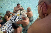 Men playing chess in the water at Szechenyi thermal baths, Budapest. - Philip Wolmuth - ,&,2010s,2014,activities,age,ageing population,bather,bathers,bathing,baths,board,cities,city,elderly,EXERCISE,exercises,game,games,hobbies,hobby,hobbyist,Hungarian,Hungarians,Hungary,leisure,LFL,LIFE