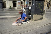 Homeless man begging at a road crossing in central Budapest - Philip Wolmuth - 2010s,2014,baggar,beg,beggar,beggars,BEGGER,begging,begs,cities,city,cross,crosses,crossing,disabilities,disability,disable,disabled,disablement,EQUALITY,excluded,exclusion,HARDSHIP,highway,homeless,h