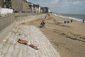 A solitary sun-bather on the beach in high season in Ramsgate, one of the five most deprived seaside towns in the UK. - Philip Wolmuth - &,2010s,2014,beach,BEACHES,coast,coastal,coasts,decline,deprivation,economic,economy,England,holiday,holiday maker,holiday makers,holidaymaker,holidaymakers,holidays,Kent,leisure,LFL,LIFE,lifestyle,OC
