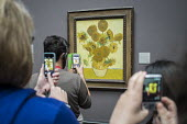 Visitors to the National Gallery London take pictures of Sunflowers by Van Gogh following the lifting of restrictions on the use of smartphones and cameras - Philip Wolmuth - 2010s,2014,ACE,amateur,art,Art Gallery,arts,arts culture,artwork,artworks,camera,camera cameras,cameras,CELLULAR,child children,communicating,communication,exhibition,fine art,Gallery,gallery gallerie