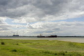 A merchant ship in the Thames estuary close to Tilbury Power Station. - Philip Wolmuth - 23-08-2014
