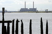 Disused dock on the Kent shore of the Thames estuary opposite Tilbury Power Station. The station burns coal, cofires oil and biomass, and is operated by RWE NPower. - Philip Wolmuth - 23-08-2014