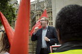 Len McCluskey, Unite Gen Sec London bus drivers protest outside Parliament and call for strike action for collective bargaining rights and equal pay. - Philip Wolmuth - 2010s,2014,activist,activists,bus,bus service,buses,campaign,campaigner,campaigners,CAMPAIGNING,CAMPAIGNS,conditions,DEMONSTRATING,demonstration,DEMONSTRATIONS,disputes,driver,drivers,DRIVING,EARNINGS