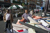 Stall at Chalton Street market, Camden, London - Philip Wolmuth - 2010s,2014,and,apparel,BAME,BAMEs,black,BME,bmes,bought,business,buy,buyer,buyers,buying,cities,city,cloth,clothes,clothing,commodities,commodity,consumer,consumers,Council Services,Council Services,c