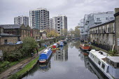 Houseboats on the Regent's Canal in Hoxton, London. There is high demand for temporary and residential moorings as a shortage of affordable housing has seen a sharp increase in numbers of those seekin... - Philip Wolmuth - &,2010s,2014,barge,barges,blocks,boat,boats,Borough,Canal,canals,cities,city,dutch,estate,estates,Hackney,High Rise,home,homes,houseboat,houseboats,houses,housing,leisure,lfL,LIFE,lifestyle,London,moo