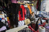 Elif Zarali has run her tailoring business from a shop on the New Era Estate for 12 years, but her lease will end in March 2015, following takeover of the estate in Hoxton, London, by US property comp... - Philip Wolmuth - 2010s,2014,apparel,BAME,BAMEs,Black,BME,bmes,Borough,bought,business,businesses,buy,buyer,buyers,buying,calls,cities,city,clothes,clothing,commodities,commodity,communicating,communication,company,CON