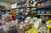 Enk Kaya set up the Caglayan Supermarket in shop premises on the New Era Estate 2 years ago, but his lease will end in April 2015, following takeover of the estate in Hoxton, London, by US property co... - Philip Wolmuth - 2010s,2014,asian,asians,BAME,BAMEs,Black,BME,bmes,Borough,bought,business,businesses,buy,buyer,buyers,buying,cities,city,commodities,commodity,company,CONSUMER,consumers,consumption,customer,customers